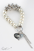 elastic pearl-bracelet with different plastic and metalbeads , heartpendant with rhinestone, nickel tested